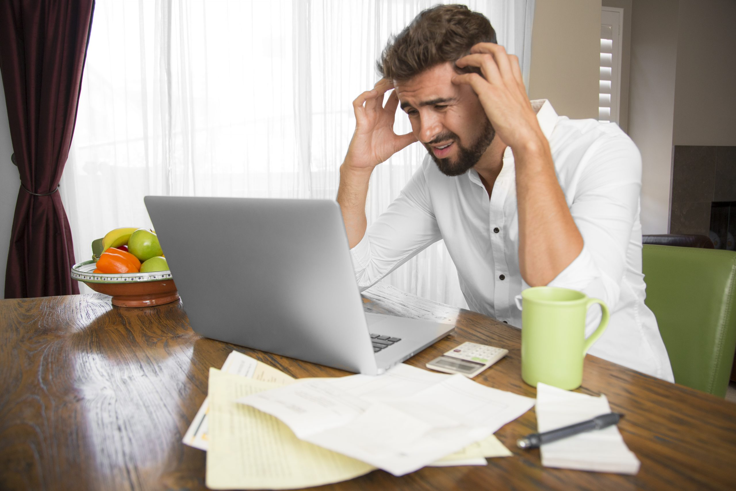 Man doing bookkeeping at home
